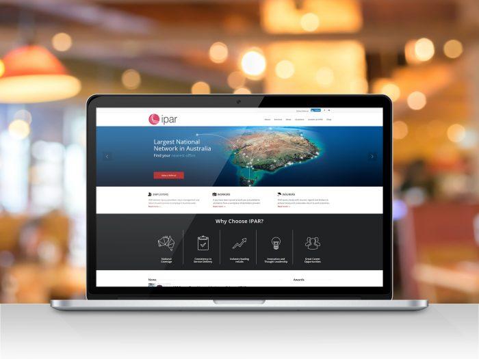 IPAR WordPress website on laptop screen