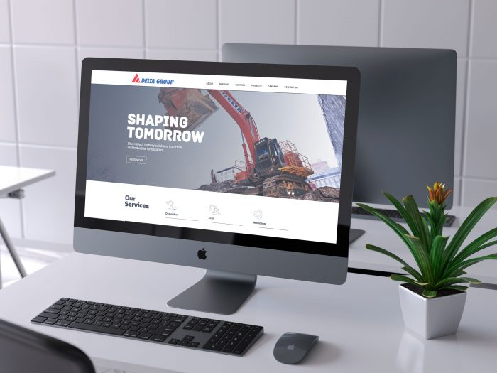 Delta Group website displayed on computer monitor